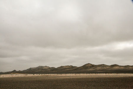 The low, black mountain range gives the place a somewhat gloomy feeling.