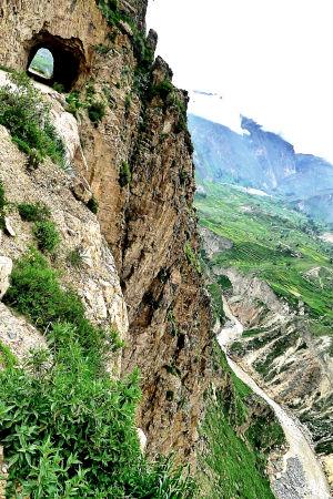 The road takes a shortcut through the mountain.